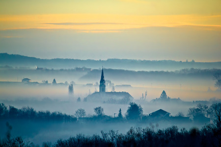 kalnik: Krizevci cathedral in fog layers landscape, Prigorje region of Croatia
