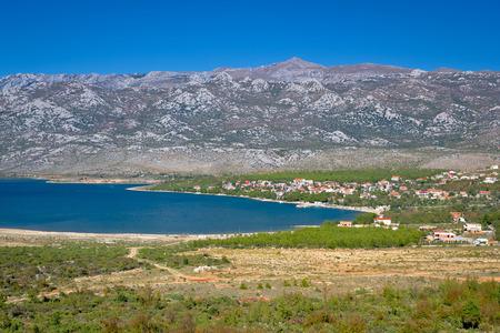 Rovanjska bay village and Velebit mountain, Dalmatia, Croatia Stock Photo
