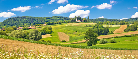 kalnik: Idyllic agricultural landscape with chapel on the hill panoramic view, Panoramic region of Croatia Stock Photo