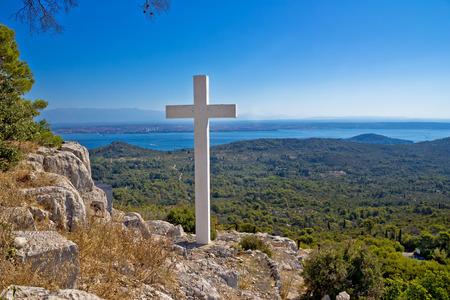 Cross overlooking islands of Croatia, top of Ugljan island in Dalmatia region