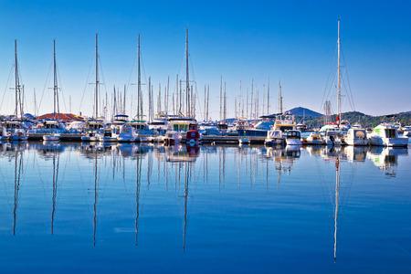 Sailboats and yachts in harbor reflections view, Tribunj, Croatia