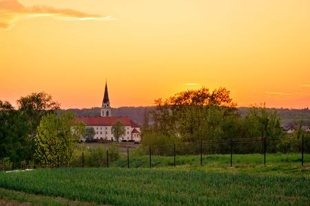 catholic cross: Greek-catholic cathedral in Krizevci, Croatia - sunset view Stock Photo