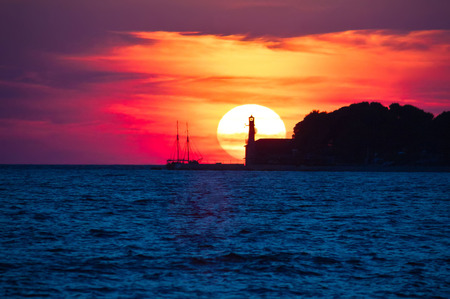 epic: Epic sunset view with lighthouse and saiboat in Zadar, Dalmatia, Croatia