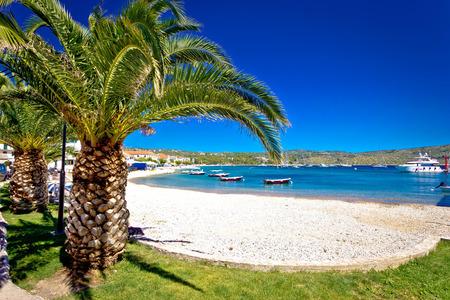 dalmatia: Idyllic palm beach in Primosten, Dalmatia, Croatia Stock Photo