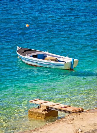 gaff: Old wooden fishermen boat on turquoise beach, Mediterranean sea