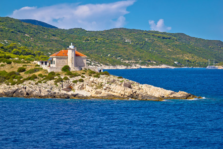 Далмация: Island of Vis lighthouse view, Dalmatia, Croatia Фото со стока