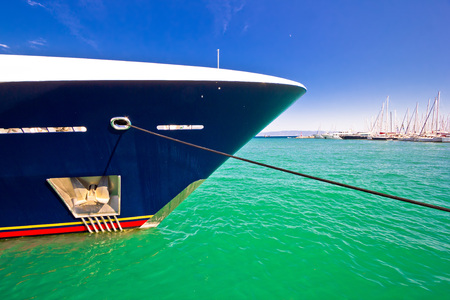 prow: Luxury yacht prow and anchor view on colorful sea Stock Photo