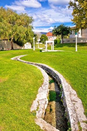 city park boat house: Town of Solin creek and park, Dalmatia, Croatia Stock Photo