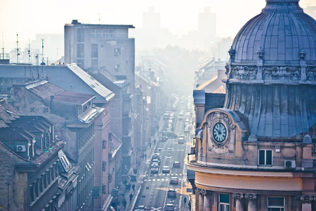 Busy Zagreb street in morning haze with old arcchitecture aerial vie, capital of Croatia