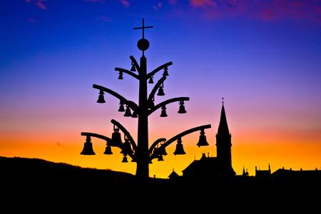 saint mary: Marija Bistrica marian shrine architecture silhouette at sunset, Zagorje region of Croatia