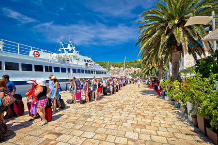 overcrowded: Hvar, Croatia, August 25, 2014: Hvar island harbor tourist queue. People waiting in line to board speedboat. Hvar is famous tourist destination, overcrowded by tourists in summenr months. Editorial