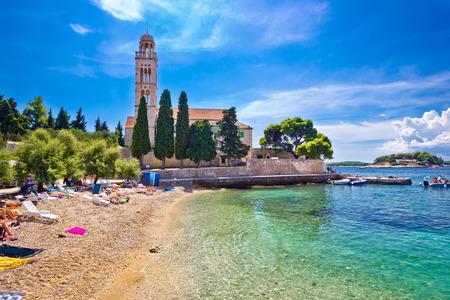 dalmatia: Hvar island turquoise beach and stone church, Dalmatia, Croatia Stock Photo