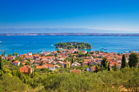 Island of Ugljan picturesque coast with Zadar and Velebit mountain, Dalmatia, Croatia Stock Photo