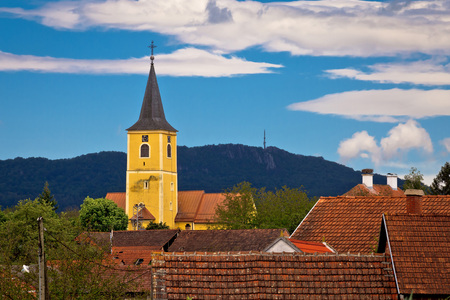 kalnik: Village of Miholec church tower and Kalnik mountain view, Prigorje, Croatia Stock Photo