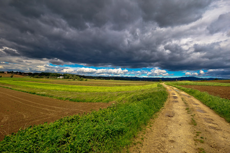 kalnik: Stormy clouds above countryside road, miholec village, Prigorje region of Croatia
