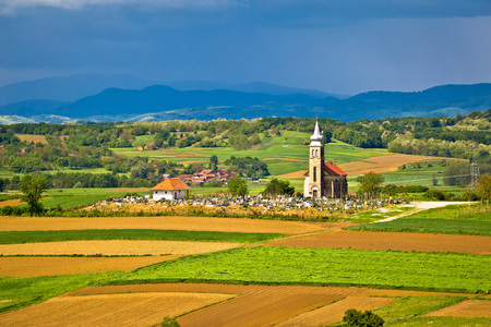 Church and graveyard on picturesque landscape, region of Prigorje, Croatia
