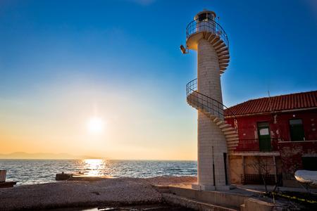 dalmatia: Lighthouse in Zadar at sunset, Dalmatia, Croatia Stock Photo