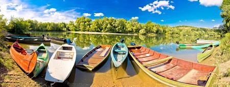 drava: Colorful boats on Mura Drava mouth pannoramic view, Podravina, Croatia