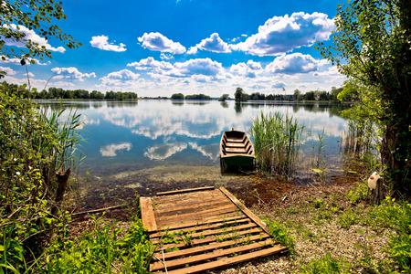 drava: Old wooden boat on Soderica lake, river of Drava, Podravina, Croatia Stock Photo
