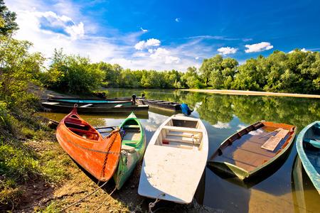 drava: Colorful boats on mouth of Drava and Mura rivers , Podravina region of Croatia Stock Photo