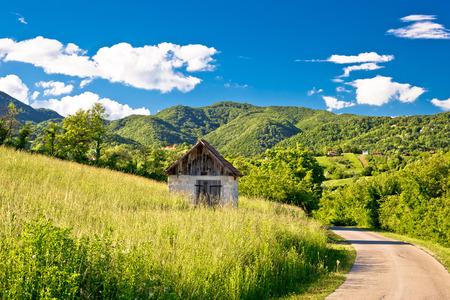 Landscape of green Zumberak hills with old stone cottage, northern Croatia Standard-Bild