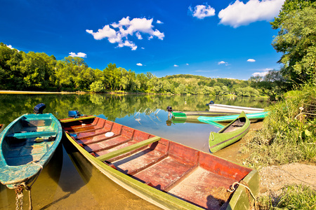 drava: Old wooden boats on Drava river, Podravina, Croatia Stock Photo