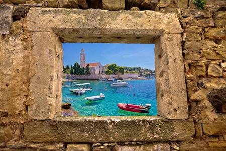 beach window: Hvar island church and stone beach window view, Dalmatia, Croatia