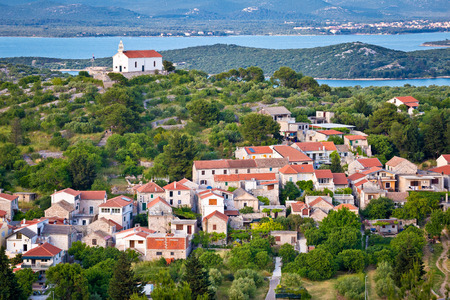 betina: Island of Murter village and hill church, historic heritage view, Dalmatia, Croatia