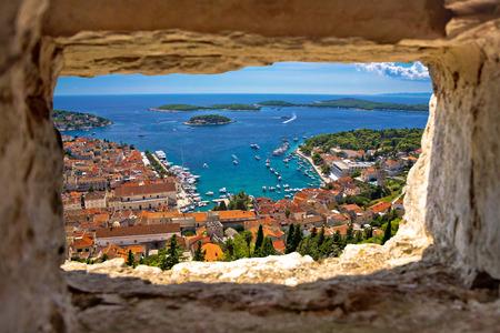 Hvar bay aerial view through stone window from Fortica fortress, Dalmatia, Croatia