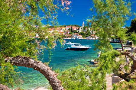 Turquoise beach of Ugljan island and town of Kali view, Dalmatia, Croatia Stock Photo