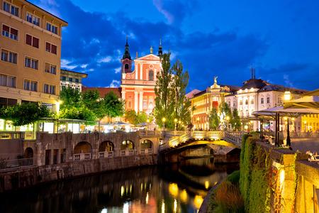 riverfront: Tromostovje bridge and Presern square in Ljubljana evening view, capital of Slovenia
