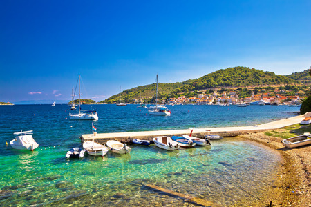 Turquoise beach and small harbor on Vis island, Dalmatia, Croatia