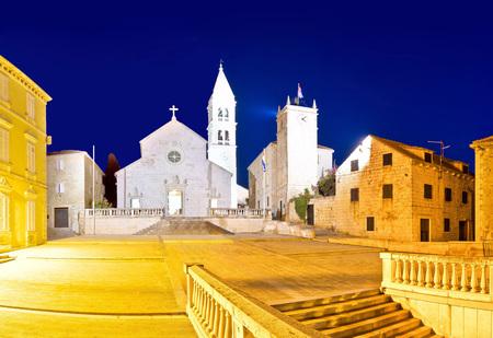 dalmatia: Church and stone squate in Supetar evening view, island of Brac, Dalmatia, Croatia