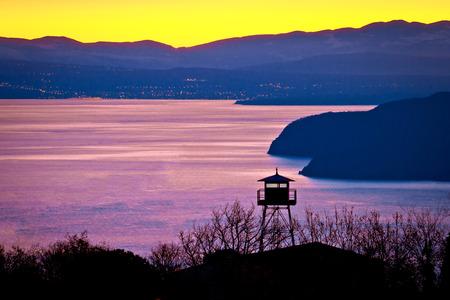 Lookout tower above Kvarner bay at golden dawn, Croatia Stock Photo