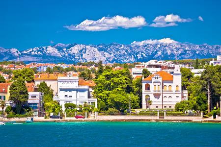 Zadar coast villas ann Velebit mountain background, Dalmatia, Croatia Stock Photo