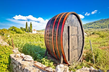 Wooden barrel on Hvar plains landscape, UNESCO world heritage site in Dalmatia, Croatia Stock Photo