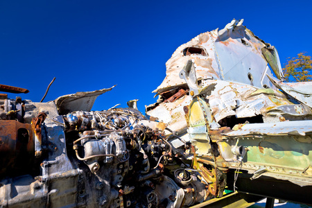 Fighter jet airplane wreck view, with blue sky background