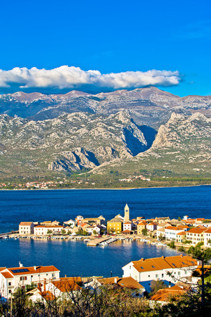 View of Town of Vinjerac with Velebit mountain Paklenica national park background, vertical view, Croatia