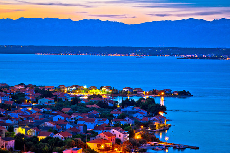 Island of Ugljan evening aerial panorama with Zadar and Velebit mountain background, Dalmatia, Croatia Stock Photo