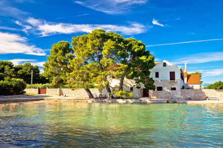 Ugljan village idyllic island beach and old architecture, Dalmatia, Croatia Stock Photo
