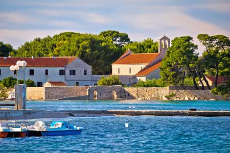 Ugljan island village old church and beach view, Dalmatia, Croatia Stock Photo