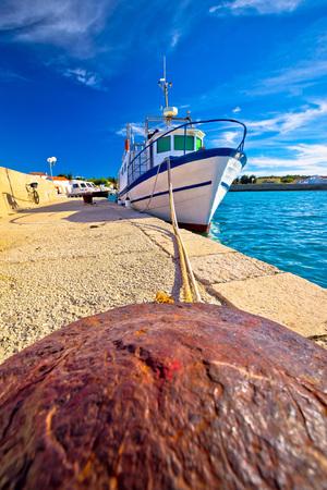 Boat on mooring bollard in Ugljan island village, Dalmatia, Croatia Stock Photo