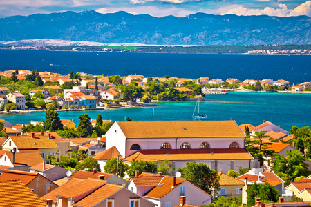 Preko village on Ugljan island bay view, Velebit mountain background, Dalmatia, Croatia