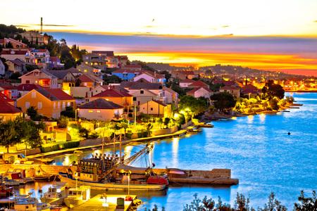 Golden sunset on Ugljan island coast, Kali and Preko villages, Dalmatia, Croatia