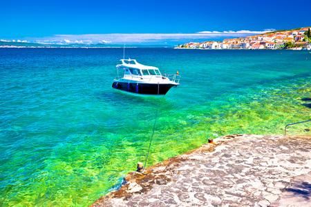 Kali beach and boat on turquoise sea, Island of Ugljan, Croatia