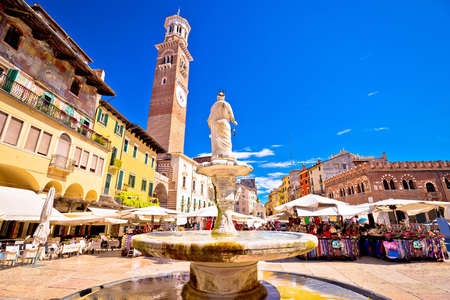 Piazza delle erbe in Verona street and market view with Lamberti tower, tourist destination in Veneto region of Italy Banque d'images