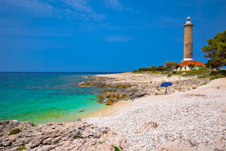 Veli Rat lighthouse and turquoise beach view, Dugi Otok island, Dalmatia, Croatia