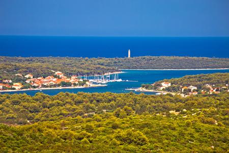 croatian: Aerial view of Veli Rat bay and lighthouse, Dugi Otok island, archipelago of Dalmatia, Croatia