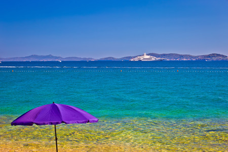 Adriatic beach in Zadar with megayacht background, Dalmatia, Croatia