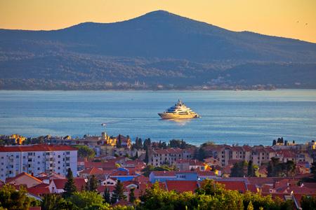Zadar waterfront and Ugljan island sunset view, megayacht in channel, Dalmatia, Croatia Stock Photo